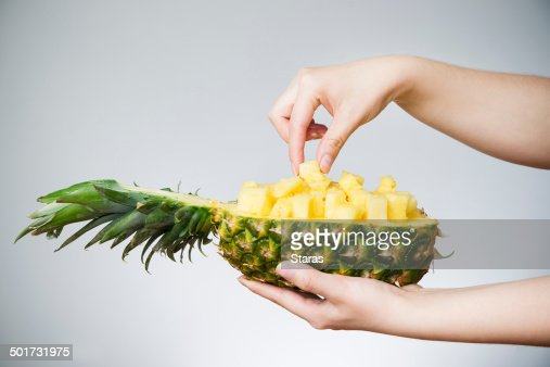 Pineapple in female hands : Stock Photo