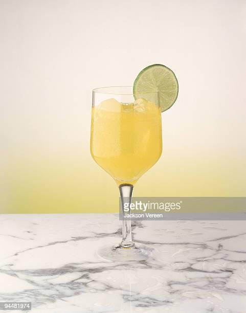 Pineapple juice with lime garnish