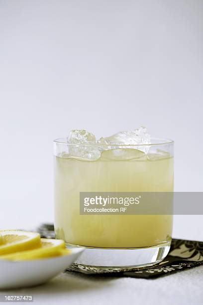 Pineapple juice with rum and ice in glass