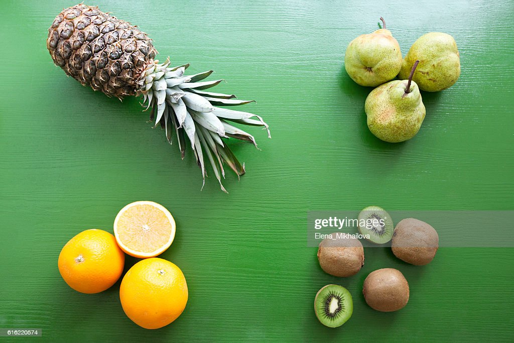 Pineapple, kiwi, pear, orange - mix of fruits : Stock Photo