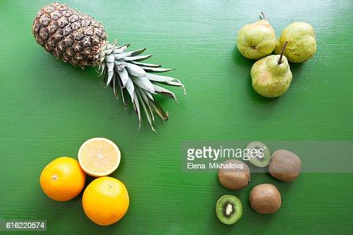Pineapple, kiwi, pear, orange - mix of fruits : Stock Photo