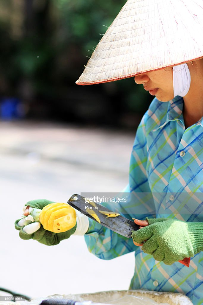Pineapple Retailer, working woman in Hanoi : Stock Photo