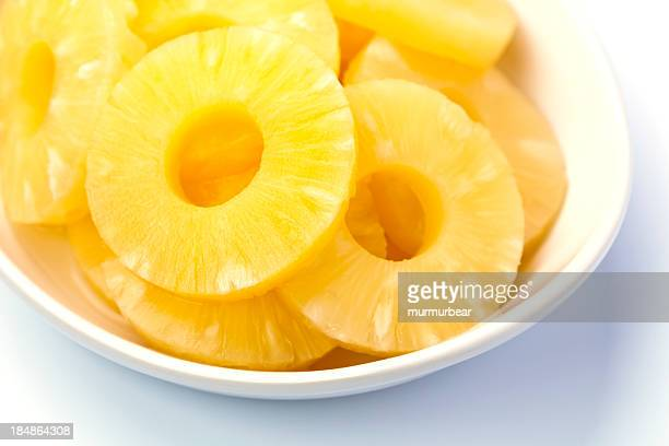 Pineapple rings served in white bowl