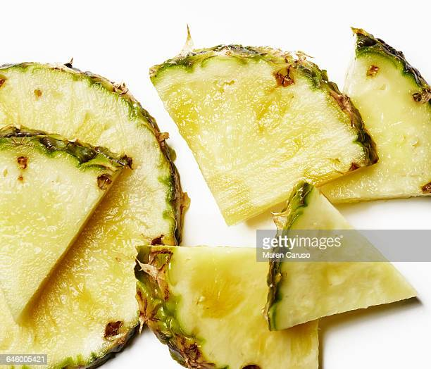 Pineapple sliced in wedges and circle