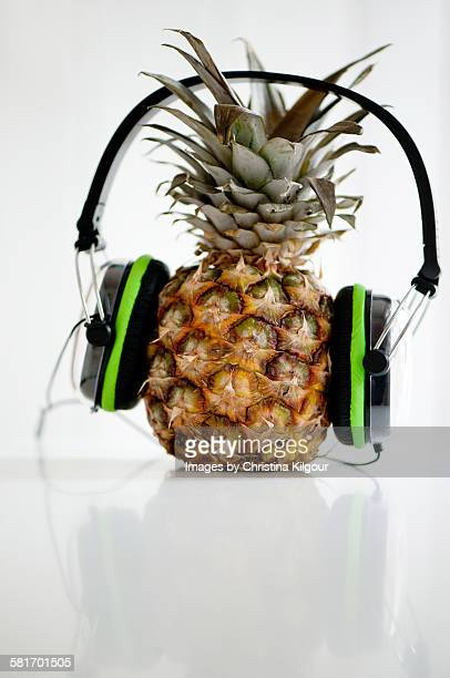 Pineapple with headphones