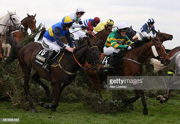Pineau De Re ridden by Leighton Aspell jumps the The Chair amongst Double Seven ridden by AP McCoy and Wayward Prince ridden by Jack Doyle on their...
