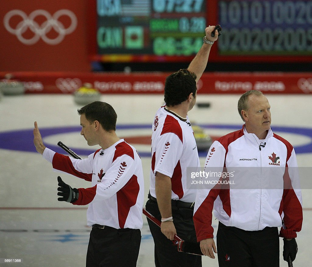 Canada's Brad Gushue (L), Jamie Korab (C) and Russ Howard (R) celebrate after the Canada vs USA match in the men's curling semi-final at the 2006 Turin Winter Olympic Games, in Pinerolo 22 February 2006. Canada defeated the US 11 to 5, and will face Finland in the final.