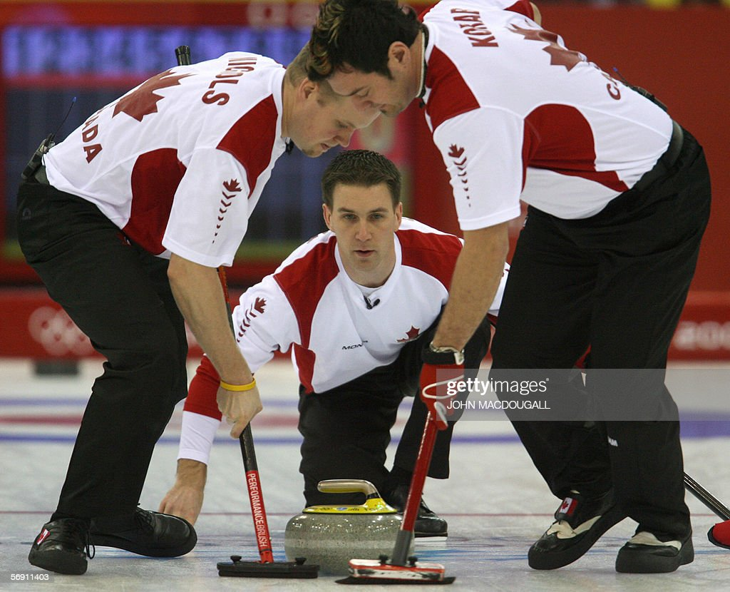 Canada's fourth Brad Gushue follows his throw during the Canada vs USA match in the men's curling semi-final at the 2006 Turin Winter Olympic Games, in Pinerolo 22 February 2006. Canada defeated the US 11 to 5, and will face Finland in the final.