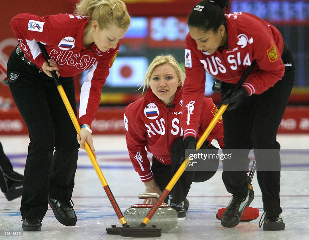 Russsia's Skip Ludmila Privivkova releases the stone during their Curling match against Japan in the women's roundrobin of the 2006 Turin Olympic...