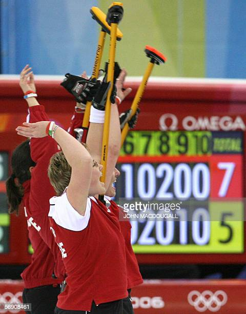 The Swiss women's curling team wave to supporters after the Canada vs Switzerland match in the women's curling semifinal at the 2006 Turin Winter...