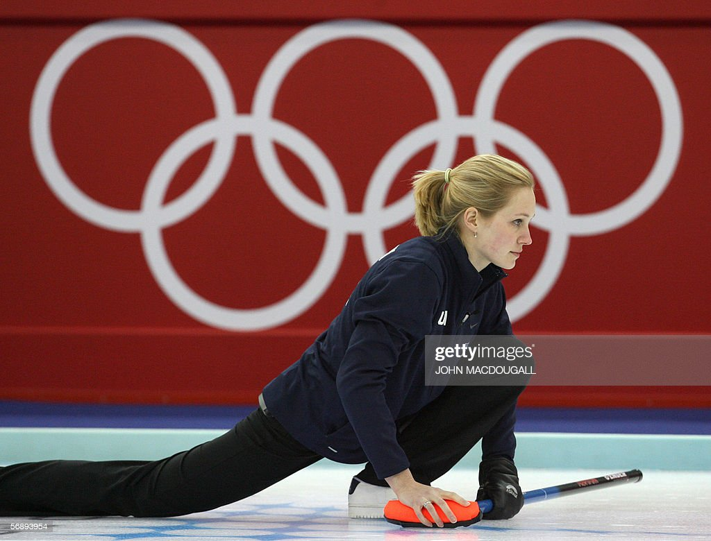 The US' skip Cassie Johnson follows her throw during the USA vs Great Britain match in the women's round robin curling event at the 2006 Turin Winter...