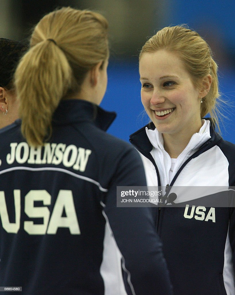 The US' skip Cassie Johnson smiles to her sister Jamie after a good throw during their match against Denmark in the women's round robin curling event...
