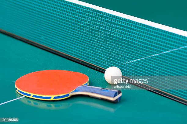 Ping pong paddle and table with net