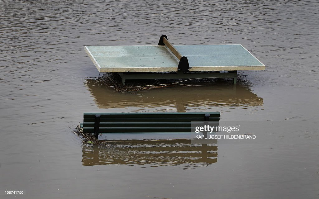 A ping pong table is flooded by the river Main on December 27, 2012 in Wuerzburg, southern Germany. Due to melting snow and rainfall, the Main burst its banks.