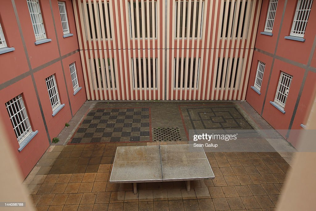 A ping pong table stands in the courtyard of the expanded youth arrest facility in Lichtenrade district on May 9, 2012 in Berlin, Germany. The facility, whose capacity is now nearly doubled, accomodates young men and women first-time offenders for short periods of time with the intent of giving them an impression of what prison is like yet to also give them a second chance at returning to freedom.