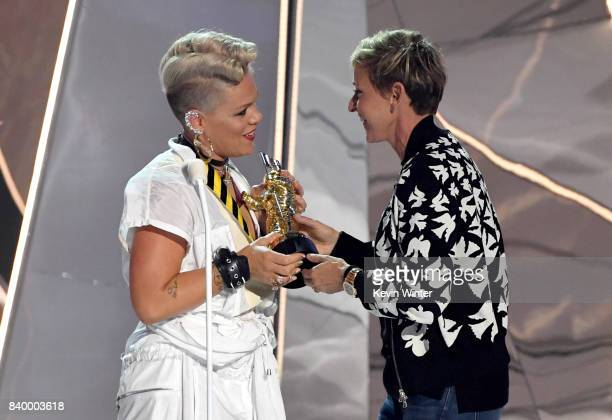 Pink accepts the Michael Jackson Video Vanguard Award from Ellen DeGeneres onstage during the 2017 MTV Video Music Awards at The Forum on August 27...