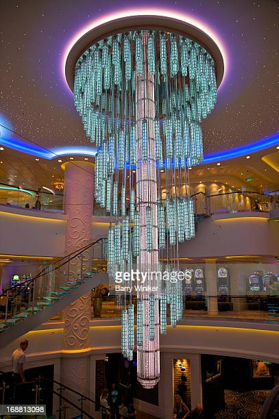 Pink and blue glass fixture hanging from ceiling