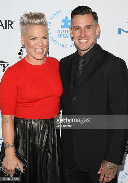 Pink and Carey Hart attend the Autism Speaks to Los Angeles celebrity chef gala held at the Barker Hangar on October 8 2015 in Santa Monica California