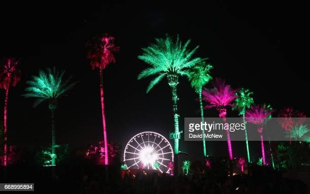 Pink and green palm trees and the ferris wheel are seen during day 2 of the Coachella Valley Music And Arts Festival at the Empire Polo Club on April...