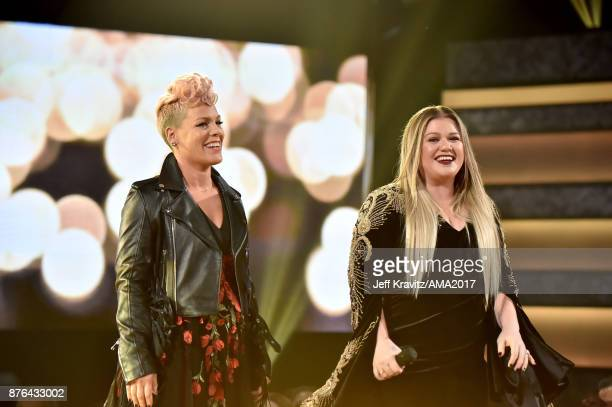 Pink and Kelly Clarkson onstage during the 2017 American Music Awards at Microsoft Theater on November 19 2017 in Los Angeles California