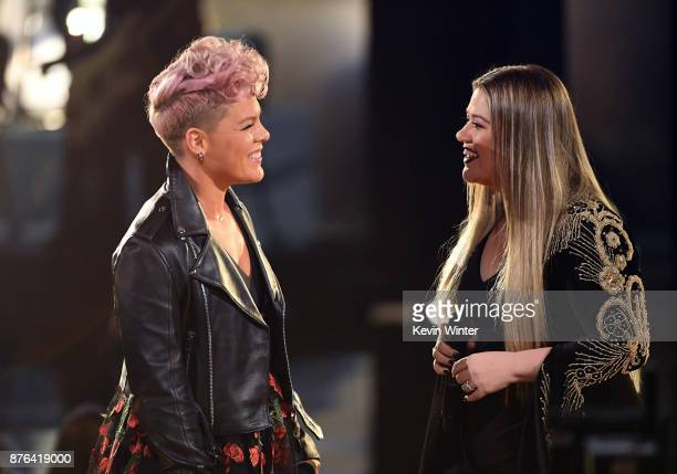 Pink and Kelly Clarkson perform onstage during the 2017 American Music Awards at Microsoft Theater on November 19 2017 in Los Angeles California