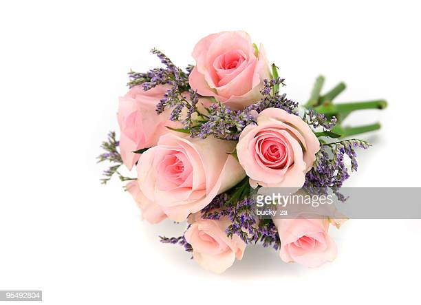 Pink and mauve rose bouquet isolated on white.