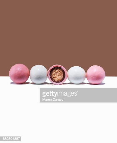 Pink and white candy malt balls