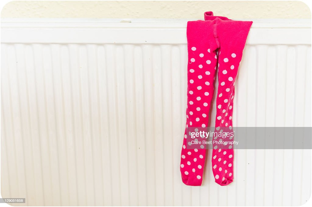 Pink and white spotted tights : Stock Photo