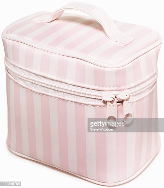 A pink and white striped make-up bag