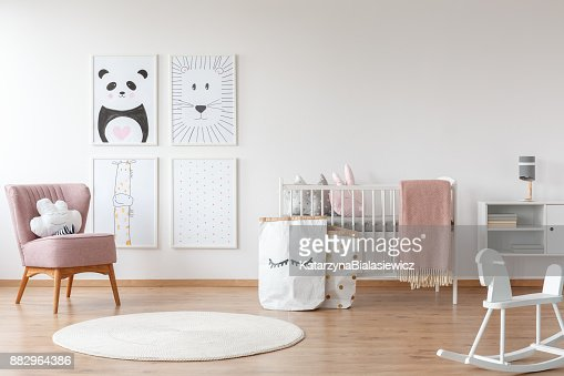 Pink armchair in child's room : Stock Photo