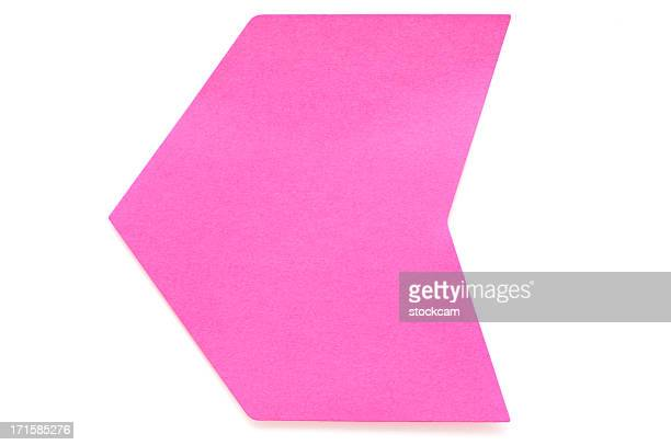 Pink arrow postit note on white