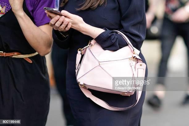 A pink bag is seen after the CDG Comme des Garcons show during Paris Fashion Week Menswear Spring/Summer 2018 on June 23 2017 in Paris France