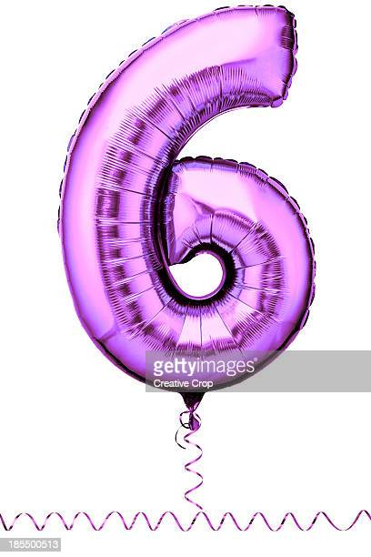 Pink balloon in the shape of a number six