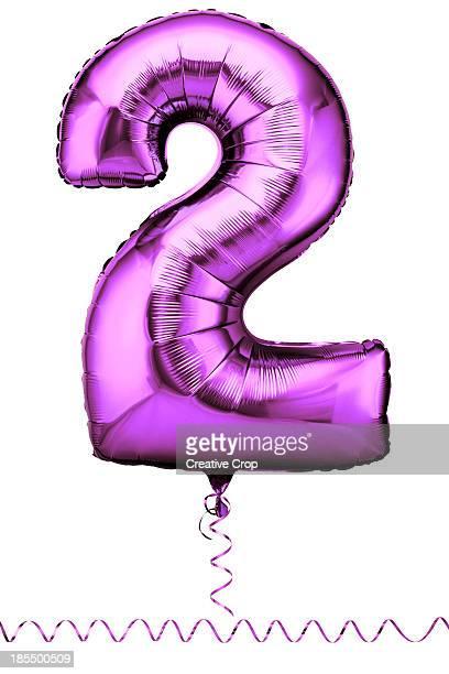 Pink balloon in the shape of a number two