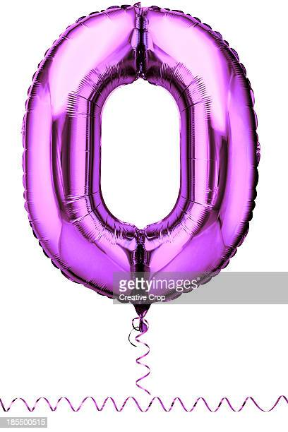 Pink balloon in the shape of a number zero