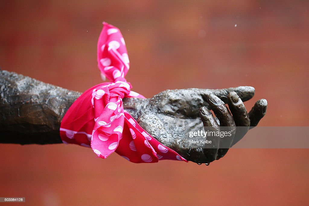 A pink bandana from Jane McGrath Day is seen on the statue of Richie Benaud in the members area as rain delays play during day three of the third...
