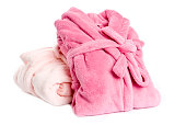 Two pink female cotton bathrobes isolated on white.