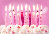 Pink birthday candles and balloons