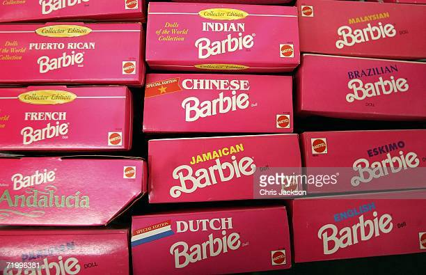 Pink boxes of different nationality barbie dolls lie at Christies South Kensington as part of a collection of 4000 barbie dolls that will be...