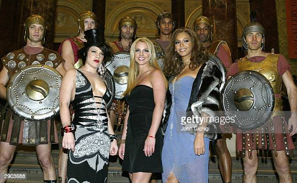 Pink Britney Spears and Beyonce Knolwes pose with some Gladiators for the cameras during the Premiere for the new Pepsi Music Commercial 'Pepsi...