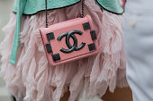 A pink Chanel bag outside Chanel during Paris Fashion Week Haute Couture F/W 2016/2017 on July 5 2016 in Paris France