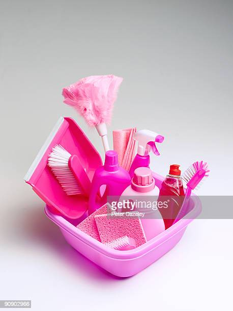 Pink cleaning materials in pink bowl.