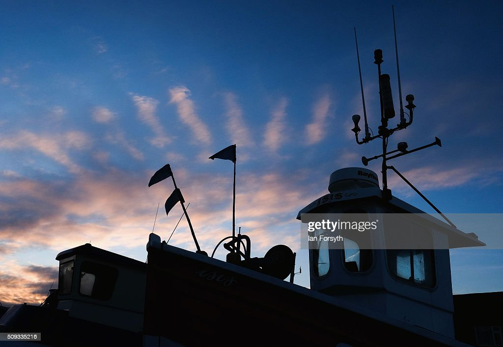 Pink clouds are lit by the sunrise above fishing boats in Fisherman's Square on February 10, 2016 in Redcar, England. The inshore fishing fleet at Redcar originated in the early 14th Century with crab, lobster and fishing bringing in much needed income to local fishermen. As the fishing industry has steadily declined so to the fleet has reduced in size so that today only a small number of boats still put to sea from the town to continue the fishing heritage on the east coast of England.