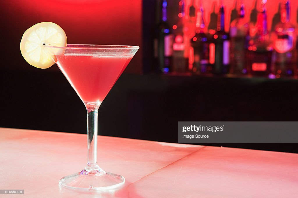 Pink cocktail on bar