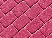 Pink color cobblestone pavement surface. abstract background and texture for design.
