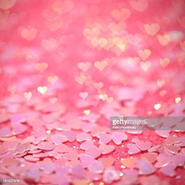 Pink confetti hearts with hearts bokeh effect