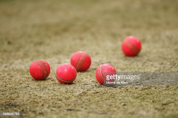 Pink cricket balls lie on he pitch during a New Zealand training session at Adelaide Oval on November 25 2015 in Adelaide Australia