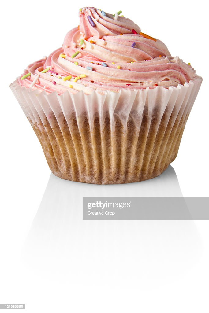 Pink cup cake, on white background : Stock Photo