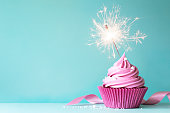 Cupcake with pink buttercream and sparkler