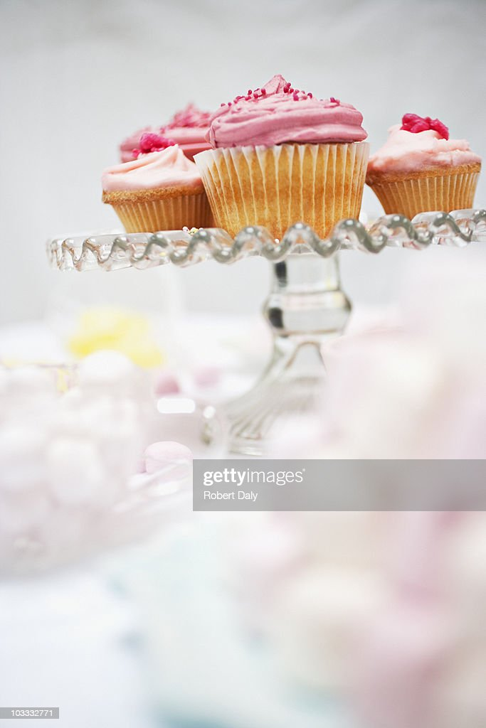 Pink cupcakes on cakestand : Stock Photo